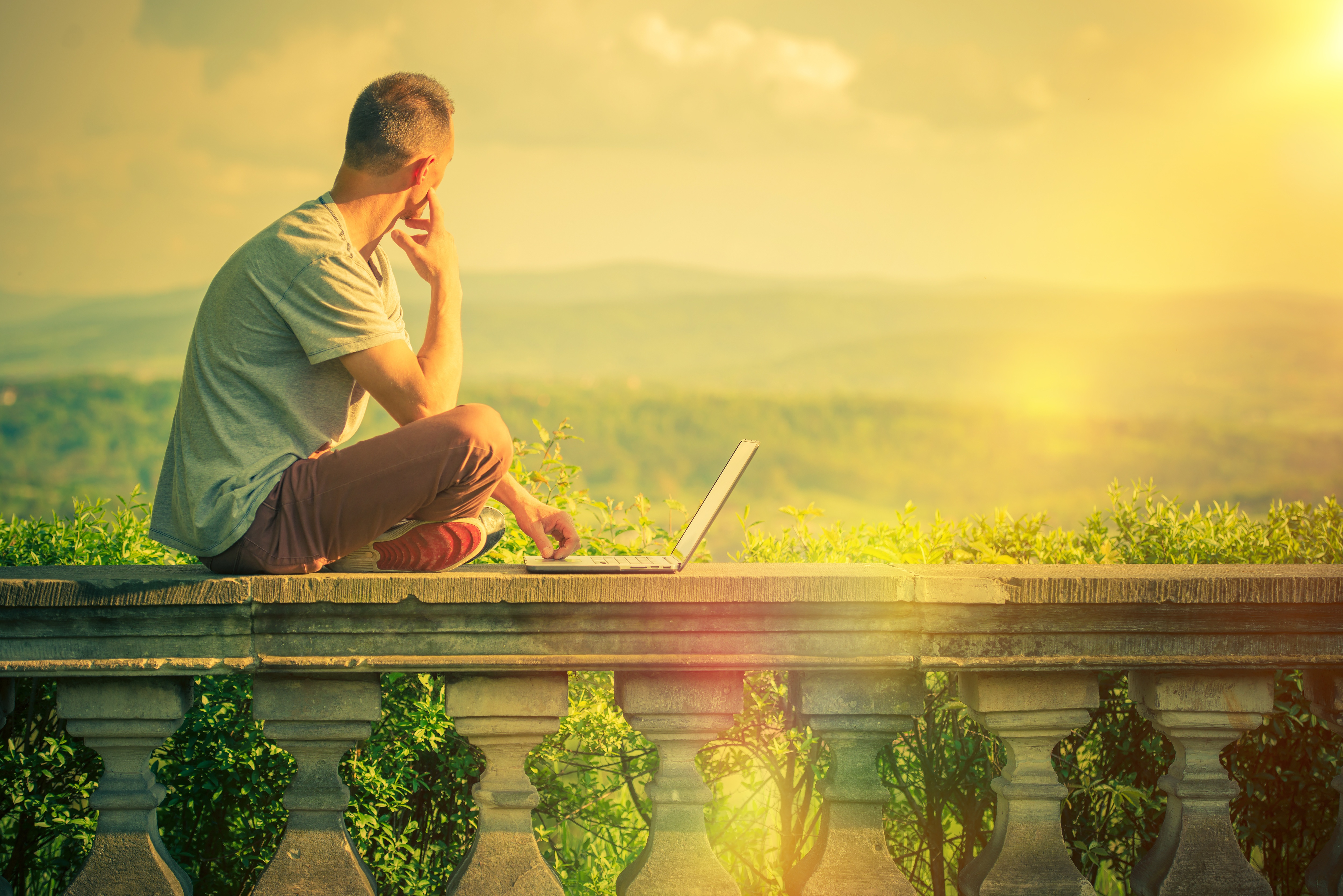Creative Outdoor Works. Creative Entrepreneur with Laptop Working at His Favorite Outdoor Place with Scenic Panoramic View.